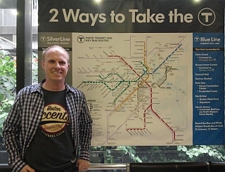 Boston Accents T-shirt in front of the MBTA Map